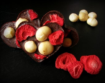Raw heart shaped chocolates with strawberries and macadamia nuts