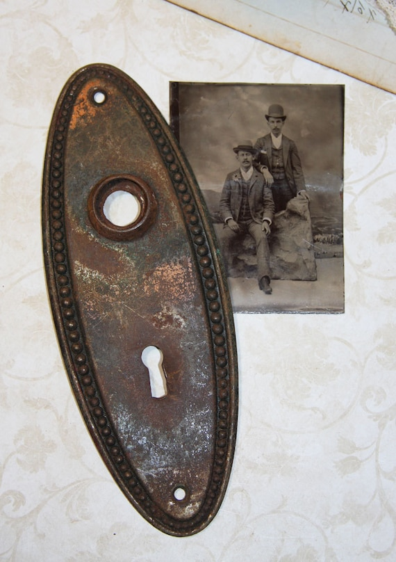 Escutcheon Plate Door Hardware With Aged Patina By