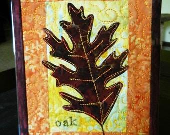 "Oak Leaf Mini Art Quilt, Batik Miniature Art Quilt, 5 x 7"" displays on easel picture frame"
