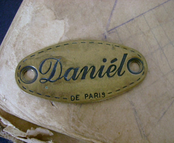 Super Swanky 1980s Vintage Brass Clothing Tag For the Lover of Daniel and Paris