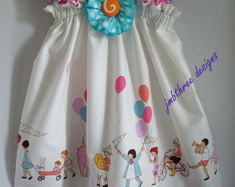 Children at Play Dress in your choice of size 12-18m,18-24mos.,2t, 3t, or 4t