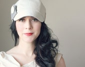 KEPP JONES ---x--- Women's newsboy hat made from vintage upcycled trousers in 'Summer Snowflake white'