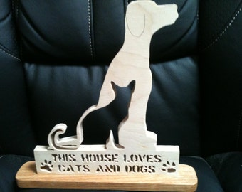 Wooden cats and dogs sign display