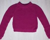 purple-magenta sweater