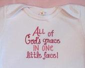 All of God's grace in one little face infant bodysuit