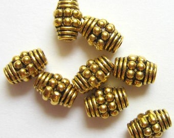 30 Oval beads antique gold metal spacer beads jewelry supply 7mm x 5mm lead free nickle free 80144-AG