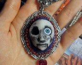 Hand sculpted broken doll head cameo necklace