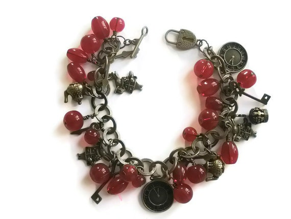 Jewelry Charm Bracelet Alice in Wonderland themed Antique Brass Red glass beads Rabbit clock face teapots