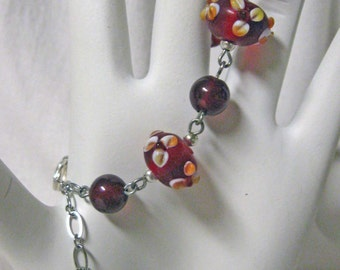 Cross charm bracelet with lampwork glass and carnelian beads - CB01-005
