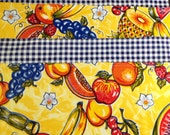 Reversible funky fruit print oilcloth placemats