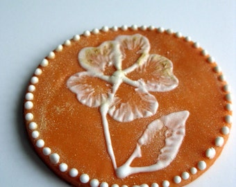 Edible orange brushed embroidered cupcake topper