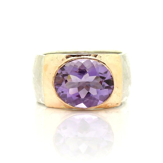 Large amethyst ring set in rose gold and a hammered silver band