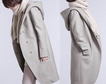 Long section of light gray hooded wool coat jacket