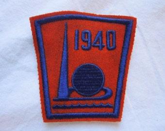 1940 World's Fair patch - orange felt with blue stitching - unused