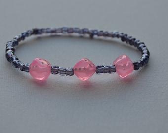 Bunco bracelet, purple glass seed beads with 3 light pink dice, stretch bracelet