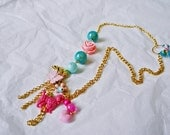 "Unique and quirky OOAK necklace, gold with kitsch pink beads and poodle ""Oy With The Poodles Already""."