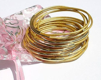Leather Bangles Bracelets Gold Leather And Gold Metal Tubes