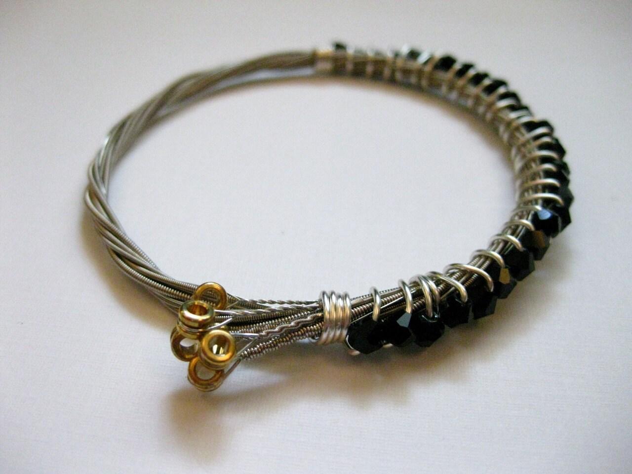 black beaded guitar string bracelet handmade by megalodesigns. Black Bedroom Furniture Sets. Home Design Ideas