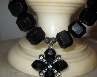 Art Deco Black Faceted Lucite Necklace with Crystal Infused Pendant
