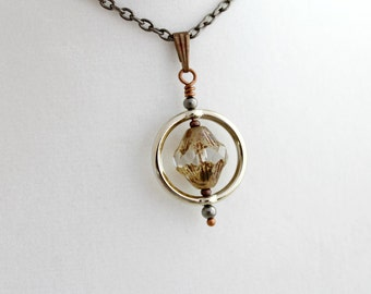 Saturn Ring Necklace with Turbine Czech glass bead - mixed metal jewelry with copper, gunmetal, & silver - spinning necklace