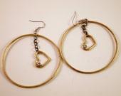 Hoop earrings with dangling hearts