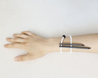 minimal tribal bracelet with black sticks and white beads, contemporary jewelry