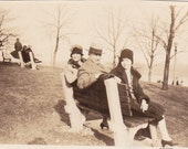 Vintage Photograph - People Sitting on a Bench (N)