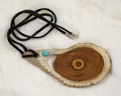 Antler and wood pendant.