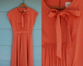 1960s-70s. coral day dress with bow tie. m