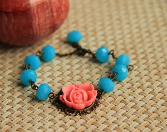 Bracelet: Pink colored rose cabochon with faceted blue glass beads, antique brass chain, perfect gift for her, mother's day gift,valentine's