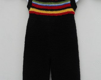 Bodysuit/jumpsuit/all in one/onesie, for a baby boy or girl, hand knitted using soft wool mix yarn in black with jolly stripes. Age 1-2 yrs