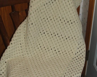 Off-white crocheted baby or lap afghan