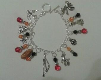 Hunger Games inspired charm bracelet -- Katniss fan jewelry
