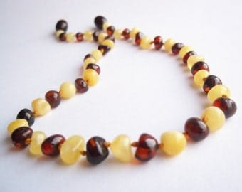 Baroque Natural  Baltic Amber Teething Necklace for your  Baby. Pain relief effective.Cherry and White Colour.
