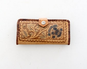 1970s tooled leather wallet