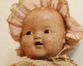 sad and broken antique German doll...