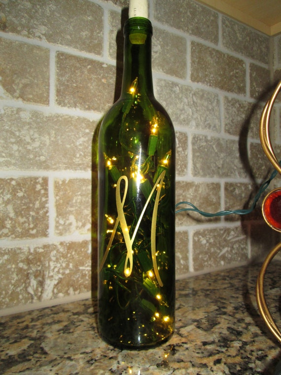 Lighted initial letter wine bottle centerpiece by for Clear wine bottle centerpieces