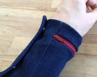 zipper cuff wallet on your wrist, denim