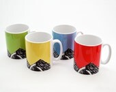 Four colourful mugs with lino print design