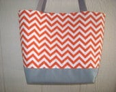 Trendy large orange and white chevron design tote bag with grey accents and a magnetic snap closure