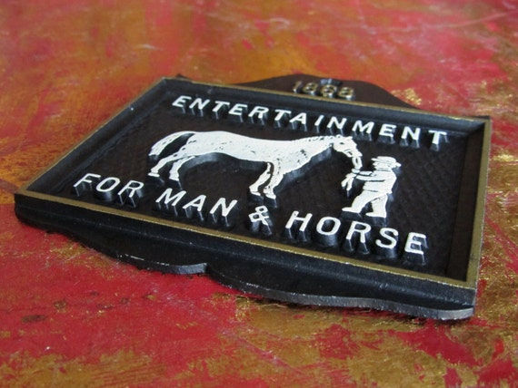 An 1888 sign advertising entertainment for man and horse. Karaoke perhaps?