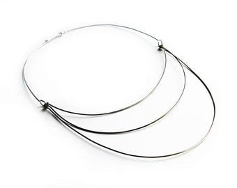 Minimalistic bib necklace of stainless steel modern silver jewelry