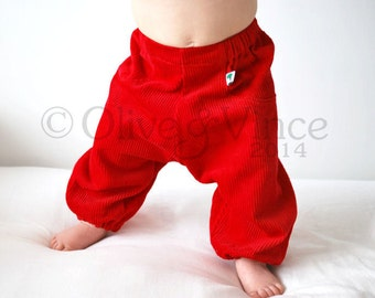 Bright red baby trousers cute bold toddler pants baggy fit cloth nappies letterbox poppy cotton corduroy comfy loose fit play kids clothing