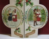RESERVED 4 M 1910's unused die cut embossed gold gilded Germany christmas card 2 scenes with different boy and girl  dressed up holly berry