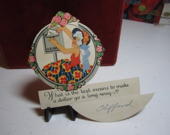 1920's art deco die cut P.f. volland novelty bridge tally place card with riddle and hidden answer pretty blonde lady mailing a letter