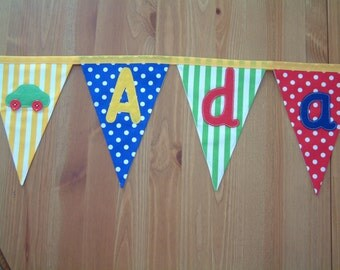 Banner, bunting. Gender neutral. Felt applique motifs: star, train, teddy, heart, car. Name. Personalised. Baby. Cotton fabric. Per flag.