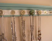 """Vintage jade jewelry organizer,This necklace rack has 7 decorative knobs and an embossed champagne background 20 """""""