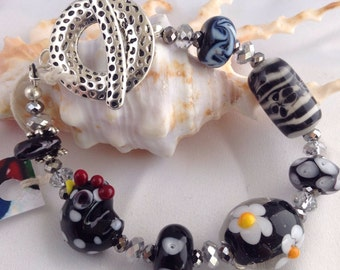 Fun black and white lamp work bracelet of handmade glass beads, all unique.
