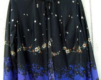 Elegant  sheer over blouse.