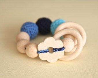 Big flower toy. Teething wooden rattle with blue crochet wooden beads and 2 wooden rings. Baby boy shower gift